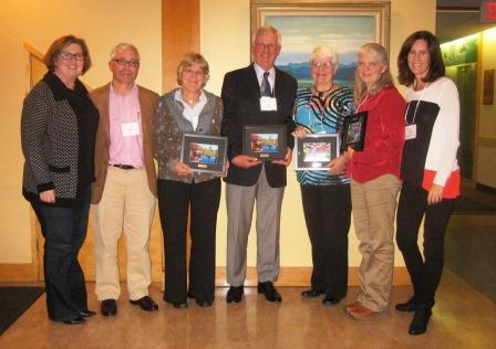 From left to right: Tanna Elliott, Chair, OLTA Governors; Chris Baines, Awards Committee; Carolyn Wallis accepting on behalf of Phyllis Callaghan; Jack Miller; Mary Vandenhoff; Valerie Fieldswebster accepting on behalf of Dexter Coolidge; Thea Silver, OLTA Executive Director.